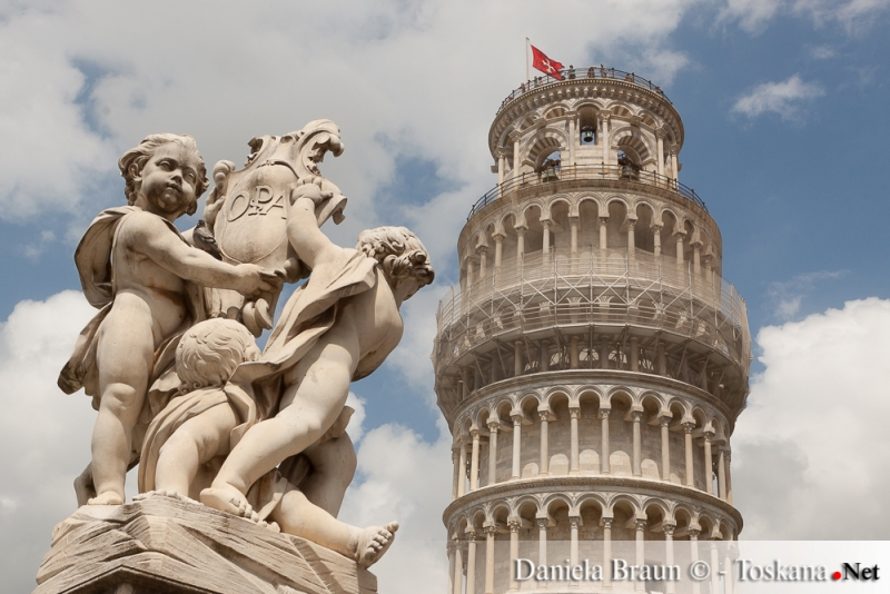 People visiting the leaning tower in Piazza dei Miracoli Pisa
