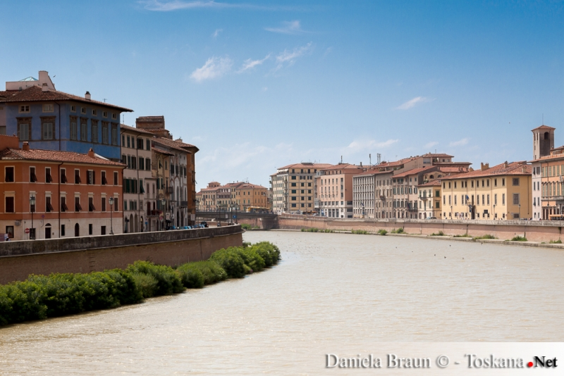 View of the river Arno flowing through Pisa in Tuscany