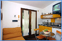 Camping Village Le Rocchette - picture of the living area bungalow typ A