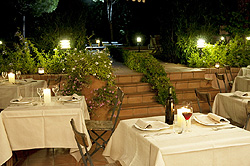 Romantic candle light dinner at the hotel restaurant during the summer time